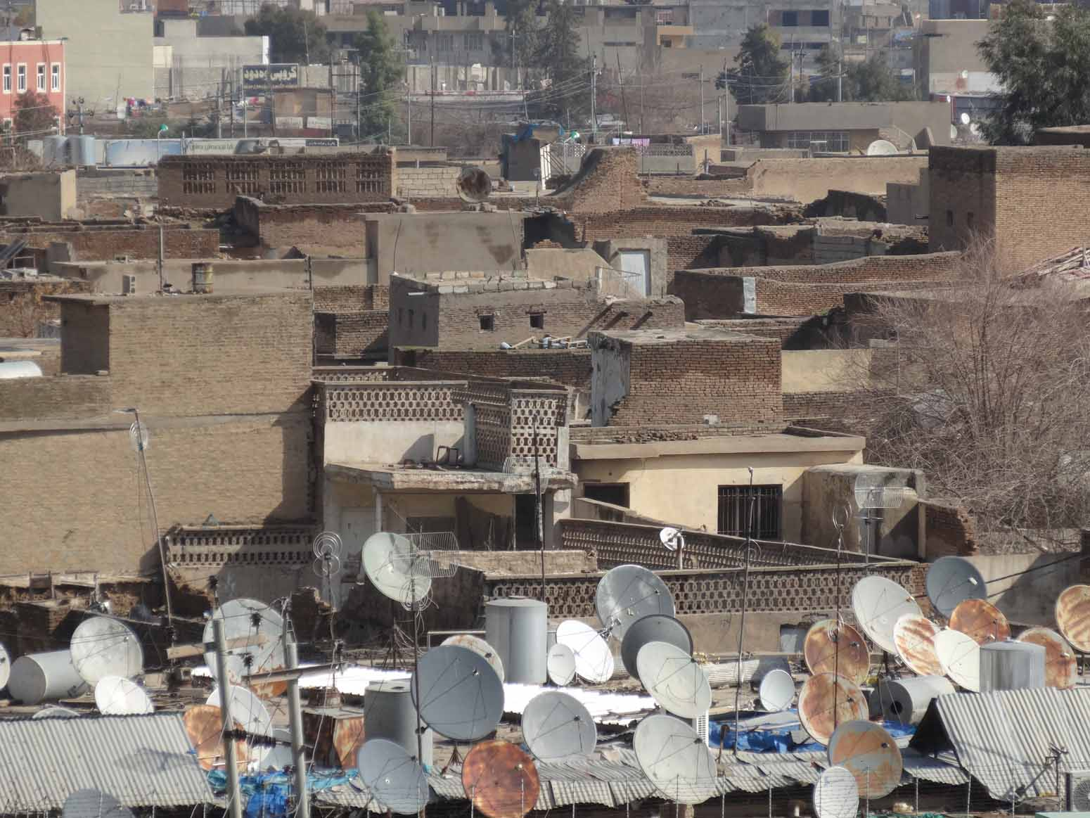 Ancient rooftops and modern satellite dishes
